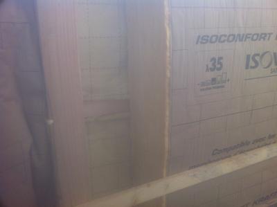 Pose de laine de verre sur un chantier à Vallet
